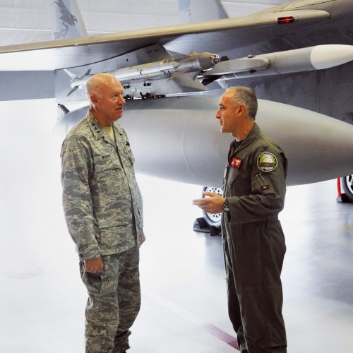 U.S. Air Force Lt. General Harry Wyatt, Director of the Air National Guard discusses the mission of the 142nd Fighter Wing with Oregon Air National Guard Operations Commander, Col. Jeffrey Silver, during Wyatt's tour of the Portland Air National Guard Base, Oct. 16.  (U.S. Air Force photo by Staff Sgt. John Hughel, 142nd Fighter Wing Public Affairs Office)