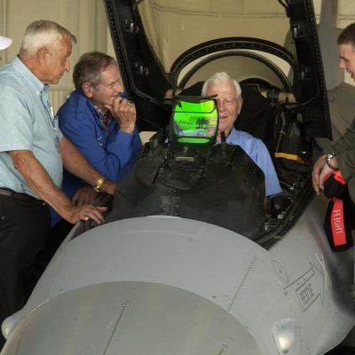 Capt. Cesar Orozco shows retired Lt. Gen. Charles Cleveland the functions of the F-16 Fighting Falcon Sept. 11 as Cols. Wilbur Carpenter (left to right), Kenneth Shealy and Ralph Gibson observe.  The four Korean War veterans were visiting Kunsan Air Base, South Korea, and sharing their experiences with 8th Fighter Wing Airmen.  Captain Orozco is with the 35th Fighter Squadron.  (U.S. Air Force photo/Senior Airman Giang Nguyen)