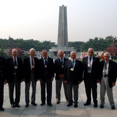 Retired Air Force members Maj. Gen. Carl G. Schneider (from left to right), Col. Robert Moxley, Lt. Gen. Charles G. Cleveland, Col. Ralph Gibson, Col. Pete Carpenter, Col. Buzz Aldrin, Col. Ken Shealy and Col. Harold Fischer stand before the Korean War Monument at the South Korean National Cemetery after a wreath laying ceremony Sept. 12. The South Korean government's Revisit Korea program invites war veterans each year to come to South Korea to honor the men and woman from 21 countries who served during the Korean War. Nearly 25,000 veterans have participated in this program since 1975. (U.S. Air Force photo/Staff Sgt. Bennie J. Davis III)