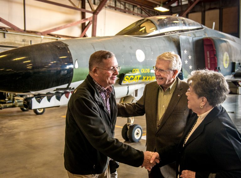 "Col. (Ret.) Charles B. DeBellevue, left, greats Major General (Ret.) William P. Acker and his wife, Nadine,  after the final military flight of the storied F-4 Phantom II at Holloman AFB, N.M., Dec. 21, 2016. Both men flew the multi-roll fighter. Debellevue was a Weapons Systems Officer (WSO) during the Vietnam War, where as a member of the 555th Tactical Fighter Squadron, the ""Triple Nickel"", stationed at Udorn Royal Thai Air Force Base. Then Capt. Debellevue, scored four kills flying with Capt. Steve Ritchie and two more flying with Capt. John A. Madden Jr. on Sept 9, 1972, making him an ace. Acker was among the initial Air Force cadre, 4453 Detachment, to fly the F-4 in 1963. (U.S. Air Force photo by J.M. Eddins Jr.)"