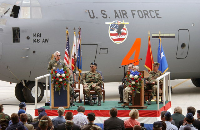 US Air Force (USAF) Brigadier General (BGEN) David Brubaker, acting Director of the California (CA) Air National Guard (ANG) speaks at a Commemorative Ceremony held for members of the 146th Airlift Wing (AW), at Channel Islands Air National Guard Station (ANGS), CA. The Ceremony celebrates the arrival of the Wing's first C-130J Hercules, Tactical Transport Aircraft. US Army (USA) Major General (MGEN) Paul Monroe, Adjutant General for the State of California is seated center stage.